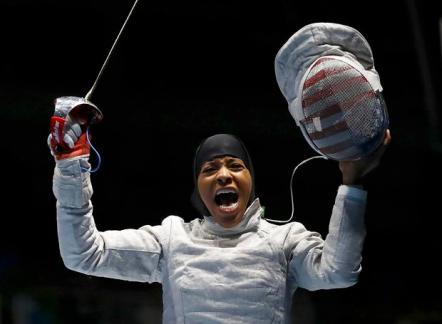2016 Rio Olympics - Fencing - Preliminary - Women's Sabre Individual Table of 32 - Carioca Arena 3 - Rio de Janeiro, Brazil - 08/08/2016. Ibtihaj Muhammad (USA) of USA celebrates winning her match. REUTERS/Lucy Nicholson FOR EDITORIAL USE ONLY. NOT FOR SALE FOR MARKETING OR ADVERTISING CAMPAIGNS.