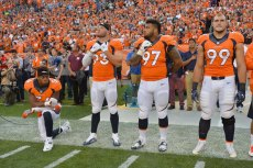 Sep 8, 2016; Denver, CO, USA; Denver Broncos inside linebacker Brandon Marshall (54) kneels during the national anthem next to defensive end Jared Crick (93) and defensive tackle Billy Winn (97) and defensive tackle Adam Gotsis (99) before the game against the Carolina Panthers at Sports Authority Field at Mile High. Mandatory Credit: Ron Chenoy-USA TODAY Sports ORG XMIT: USATSI-268224 ORIG FILE ID: 20160908_gma_ac4_210.jpg
